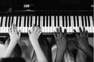 Two hands playing a keyboard. Just How Many Keys on a Piano?