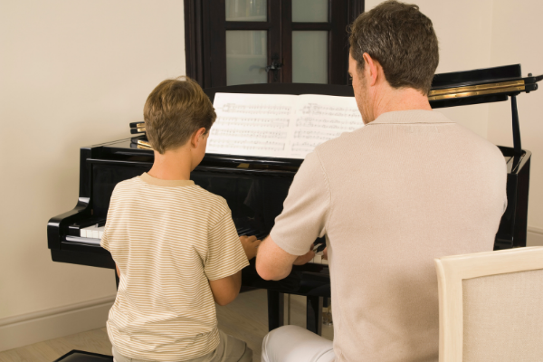 Male Piano Teacher with Male Student - Beginning Piano Instruction